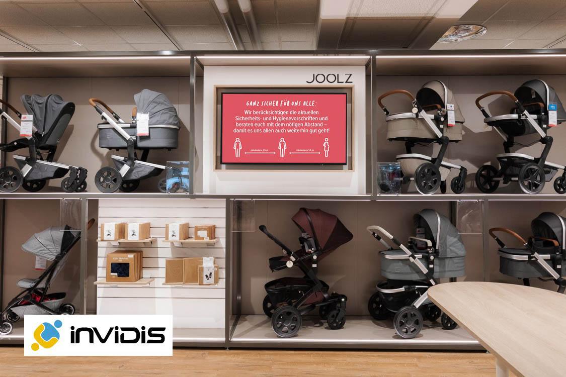 Digital Signage Bildschirm in einer BabyOne Filiale - Blogpost